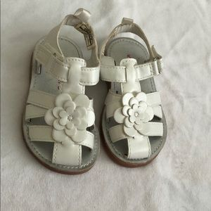 White sandals with flower detail